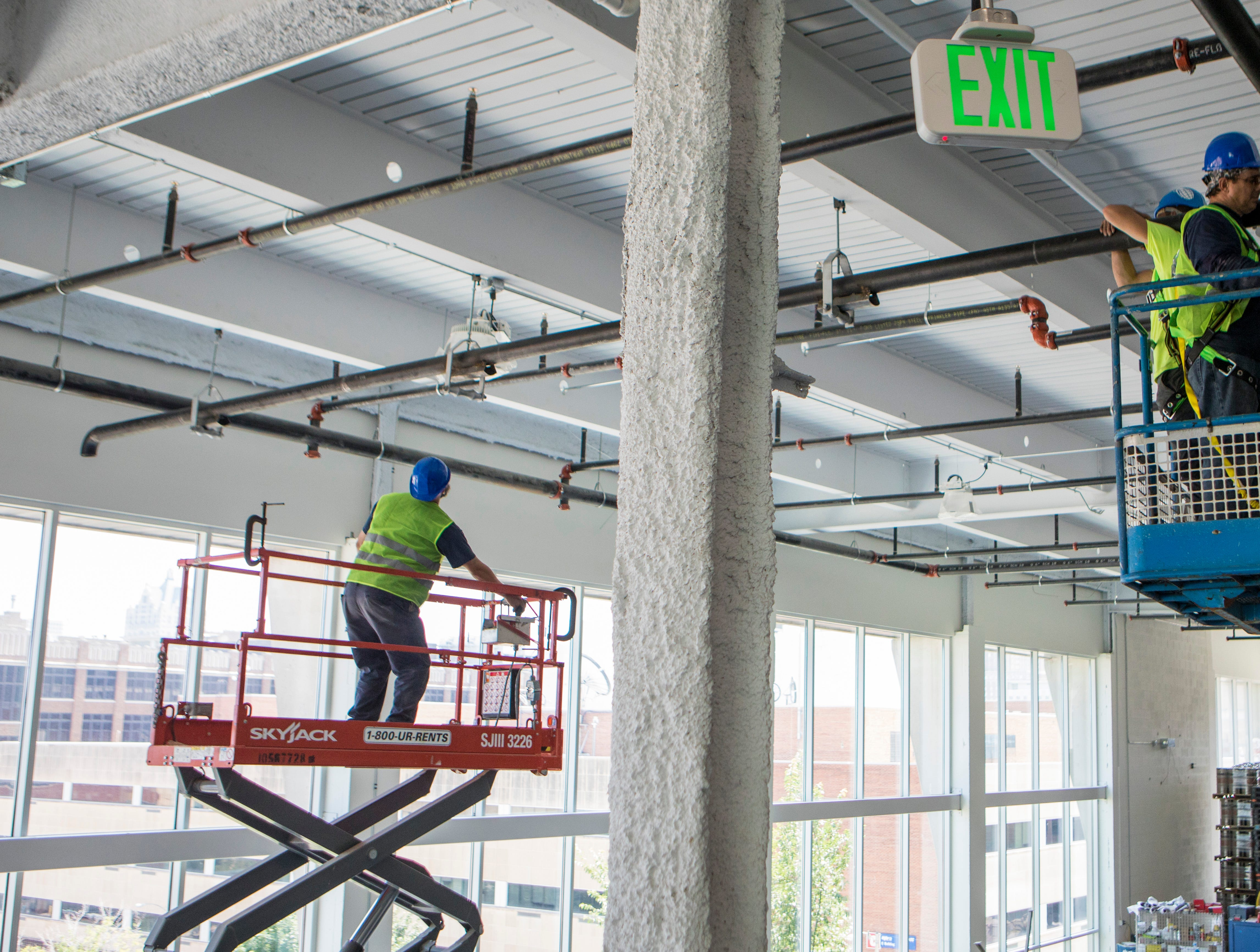 Construction workers keep up a steady pace to be ready for the MKE Brewing grand opening on Sept. 15 and 16. MKE Brewing will be part of a celebratory opening for The 42 starting Aug. 29.