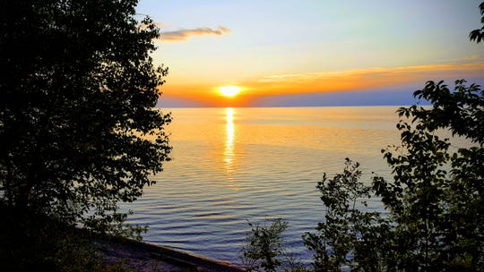 The sun sets over Lake Superior near the Porcupine Mountains Wilderness State Park in Michigan's Upper Peninsula.