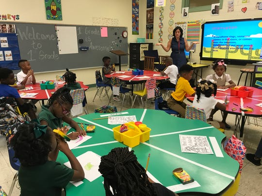 Sarah Cox talks to her first-grade class Monday at Carver Elementary School in Monroe.