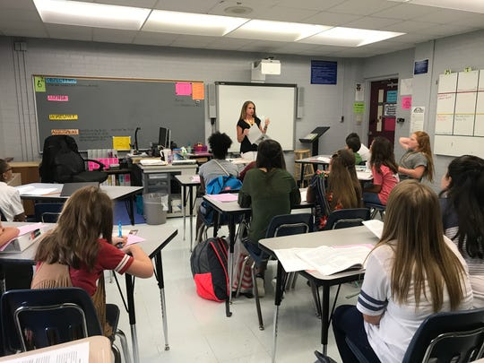 Sixth-graders learn about the student handbook Monday at Sterlington Middle School.