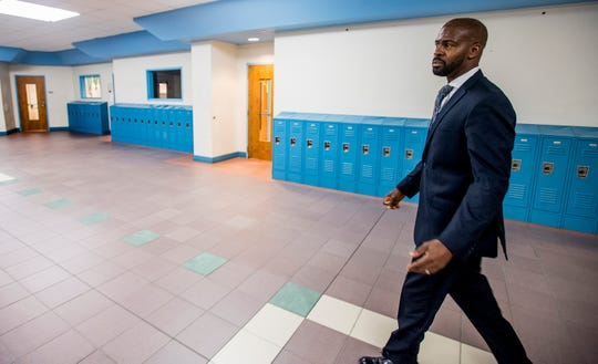 Bellingrath Middle School counselor Thomas Tullis walks the halls at the school in Montgomery, Ala. on Monday August 13, 2018.