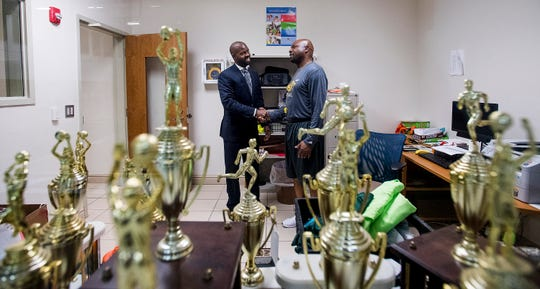 Bellingrath Middle School counselor Thomas Tullis, left, pauses to talk with coach Cedrick Webb, right, at the school in Montgomery, Ala. on Monday August 13, 2018.
