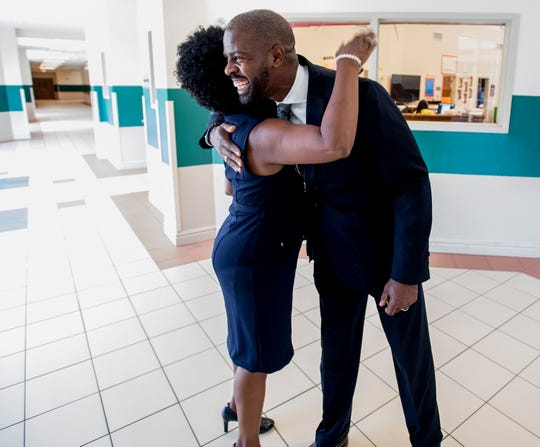 Bellingrath Middle School counselor Thomas Tullis hugs media specialist Carolyn Berry at the school in Montgomery, Ala. on Monday August 13, 2018. After years of working together, they refer to each other as Brother and Sister.