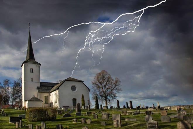 File photo of lightning striking near a church.