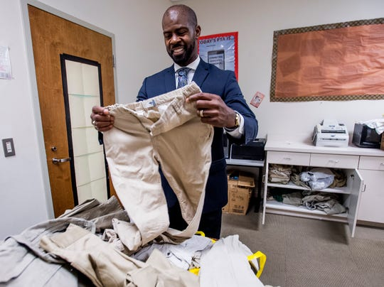 Bellingrath Middle School counselor Thomas Tullis sorts through donated uniforms that will be used for students that need them at the school in Montgomery, Ala. on Monday August 13, 2018.