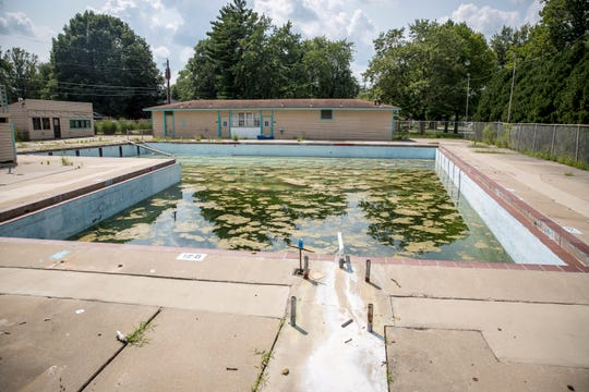 The pool area of Halteman Village sits is disarray after being closed down a year ago. The city is still in deliberation about what to do with the property.