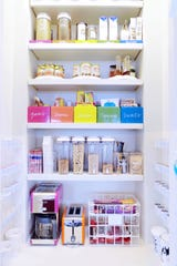 Kitchen shelves organized by The Home Edit.