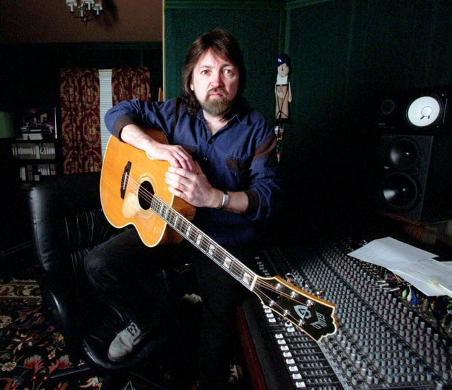 """Blue Miller in his studio Feb. 13, 2002, with the """"Guild"""" guitar and soundboard used in the recording of the multi-Grammy nominee India.Arie's album. His 1972 """"Guild"""" guitar is an F-50 made some twenty years ago."""