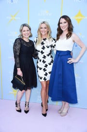 "Joanna Teplin (left), actress Reese Witherspoon (center) and Clea Shearer pose on the red carpet for the launch of Witherspoon's new television network Hello Sunshine in August 2018. Teplin and Shearer's new show on the network, ""Master the Mess,"" is a series featuring decluttering home makeovers."