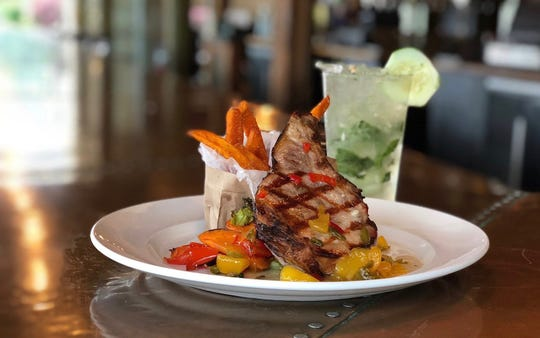 Smoked pork chop and Cucumber Cooler cocktail are on the summer grilling menu at Burntwood Tavern.