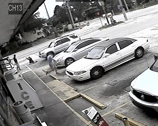 In this Thursday, July 19, 2018, image taken from surveillance video released by the Pinellas County Sheriff's Office, Markeis McGlockton, far left, is shot by Michael Drejka during an altercation in the parking lot of a convenience store in Clearwater.