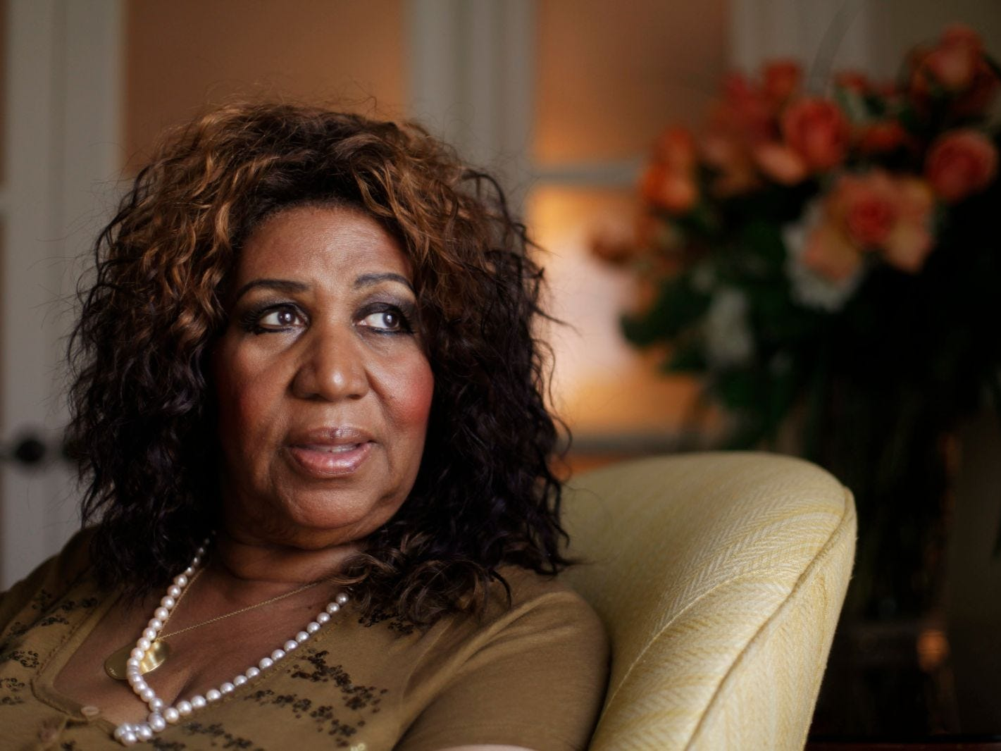 In this July 26, 2010 photo, performer Aretha Franklin looks out a window, in Philadelphia. Franklin says she believed Whitney Houston had overcome her demons and was primed for a comeback, which made learning of the troubled singer's death all the more of a shock. Interviewed on NBC's Today show Friday, Feb. 17, 2012, Franklin said she was watching TV in her hotel room in Charlotte, N.C., when she learned of Houston's death.