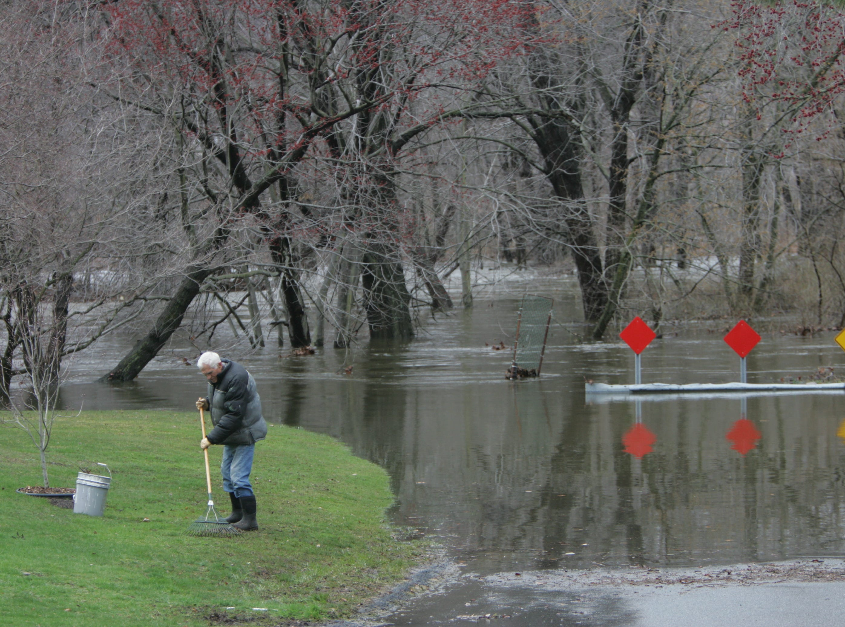 April 16, 2007: 76-year-old Sigmund Strysko rakes debris from his lawn, as flood waters recede follwing a Nor'Easter. His home is very close to where the Mahwah and Ramapo Rivers merge. He says only during Hurricane Floyd has he seen the water higher.