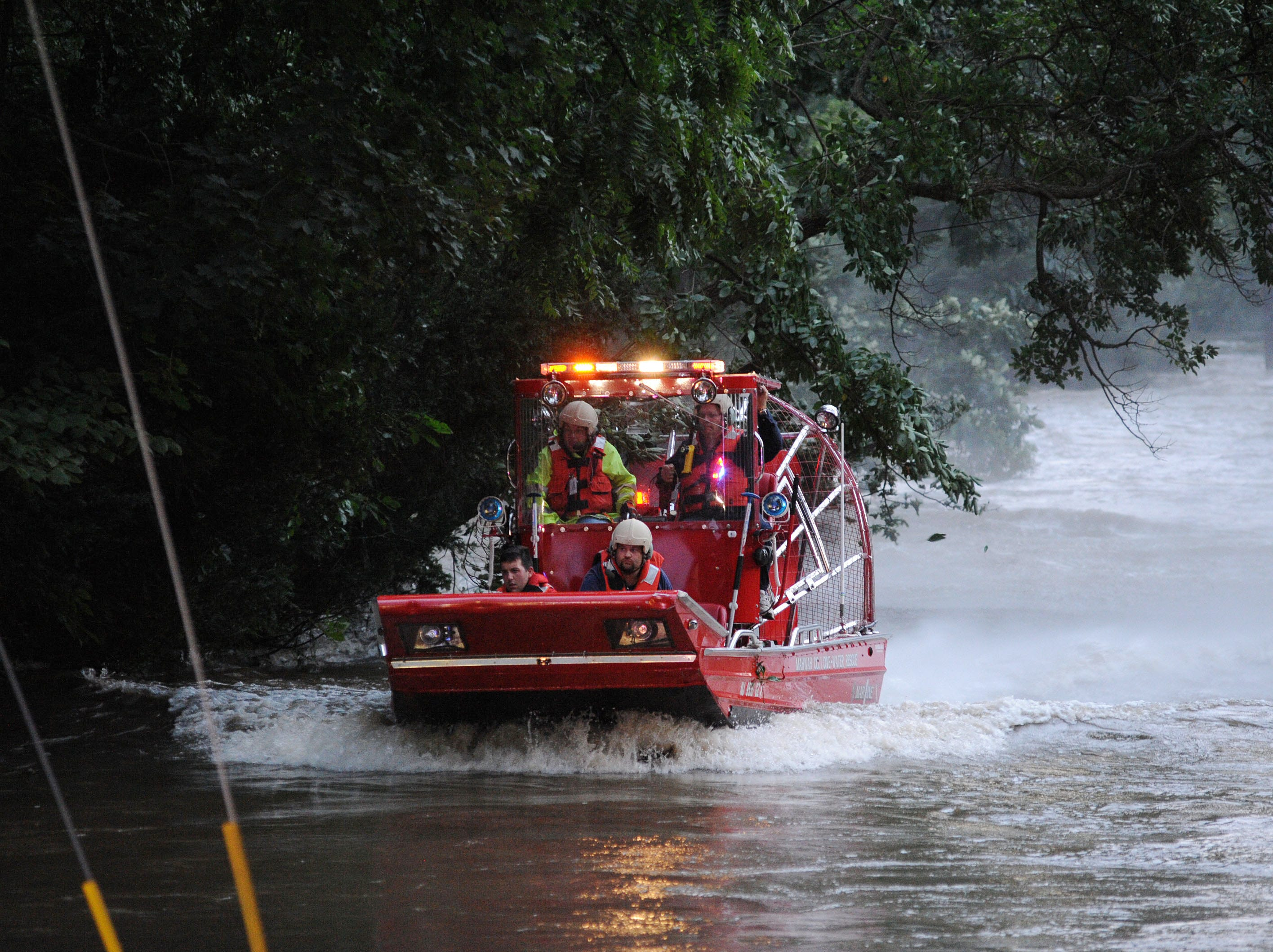 Aug. 28, 2011:  A boat that rescued a man that was up to his neck in rapidly moving water while holding onto some trees for about an hour on Lakeshore Drive in Oakland. The flood waters were caused by flooding from Hurricane Irene mixing with already high rivers.