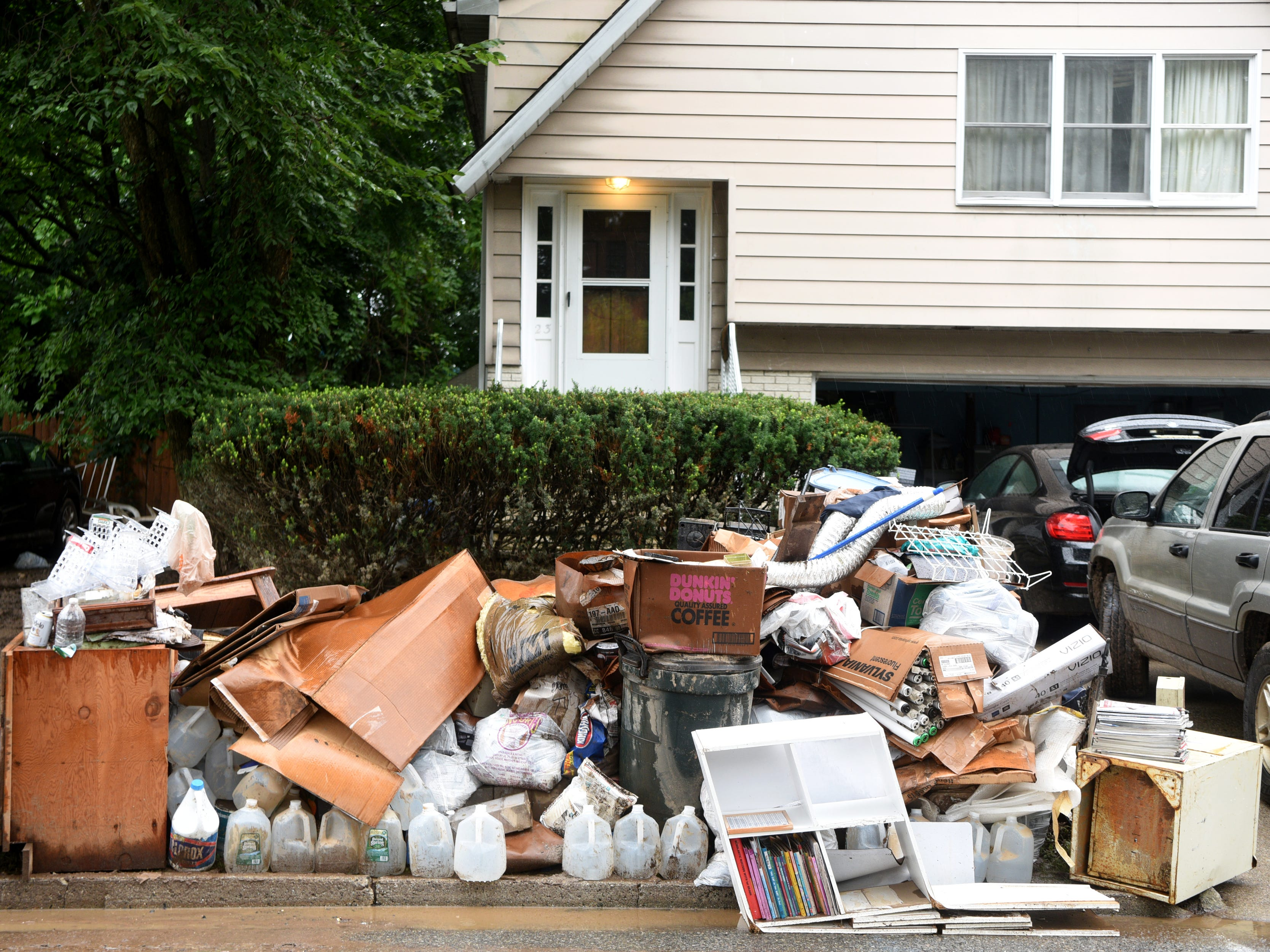 Items ruined in flooding are removed from a home on Cedar St. in Little Falls sit on the street on Monday, August 13, 2018. Flooding in the neighborhood near the Peckman River on Saturday is being called the worst since Hurricane Floyd.