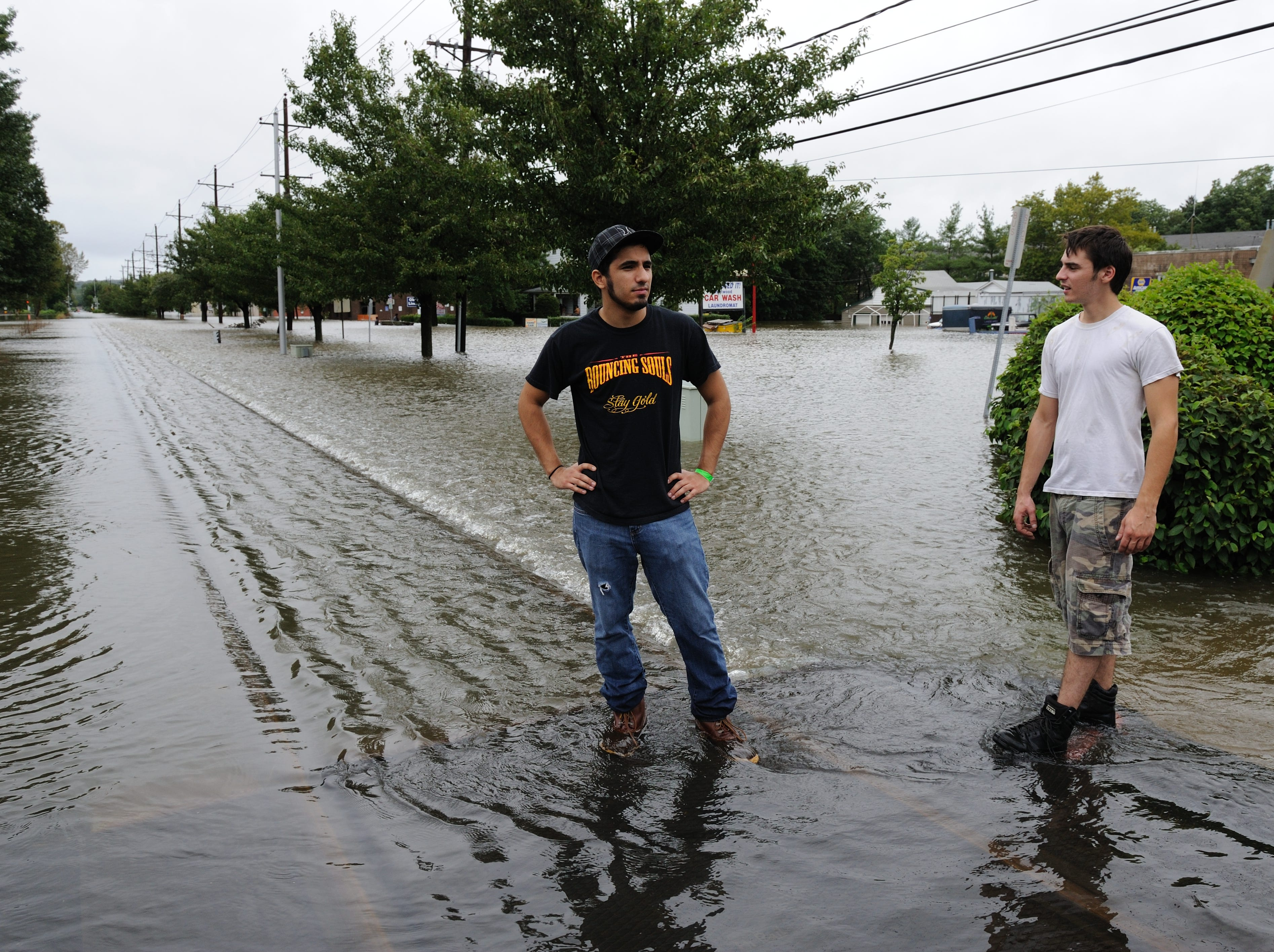Aug. 28, 2011: Alfred Chester of Oradell, left and Anthony Mairowicz of Hackensack look at the flooding on Broadway in Westwood.