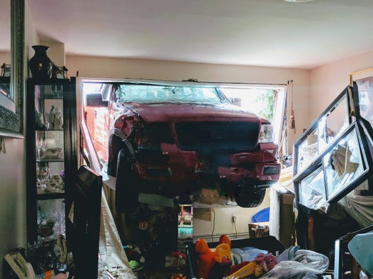A pickup truck crashed through a window into an apartment on Monday, after a three car accident in Hackensack