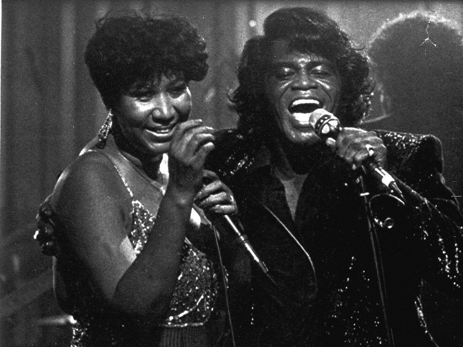 Singers James Brown and Aretha Franklin perform at the Taboo night club in Detroit Saturday night, Jan. 11, 1987, for a show which was taped for airing on HBO.