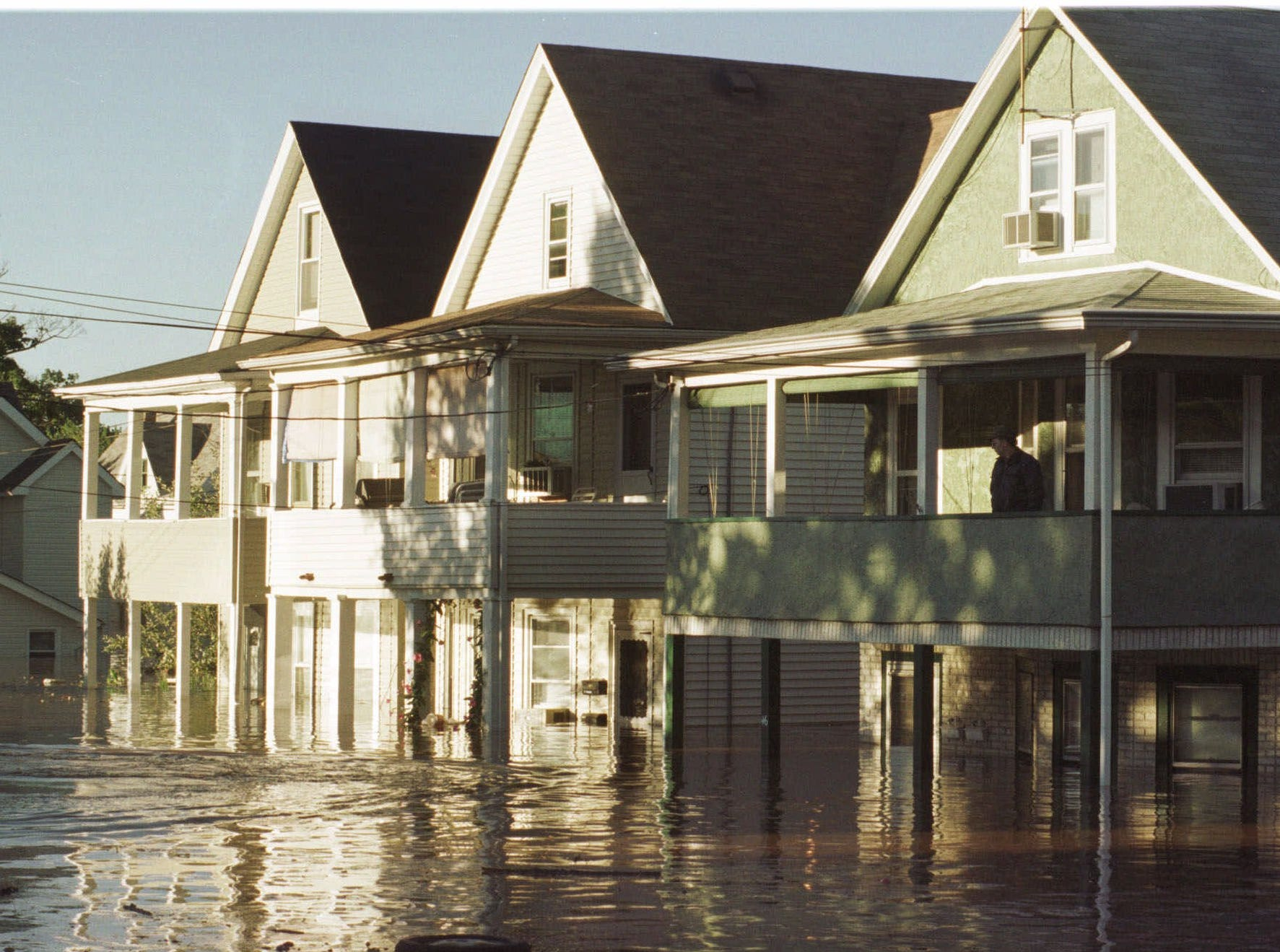 Sept. 17, 1999: An unidentified man surveys his flooded neighborhood in Bound Brook from his second floor porch. Rain fall from Hurricane Floyd flooded many areas near streams and rivers throughout the state.