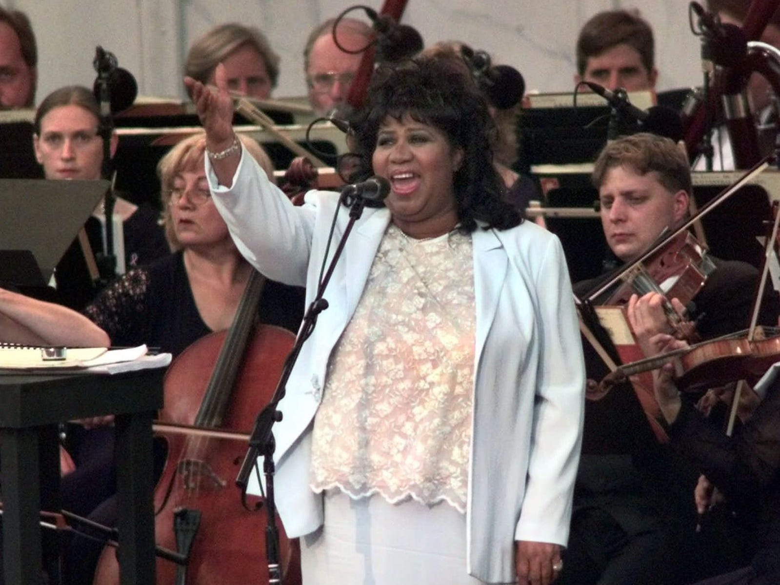 "Aretha Franklin sings the national anthem at the beginning of ""The Three Tenors"" concert at Tiger Stadium in Detroit, Saturday, July 17, 1999."