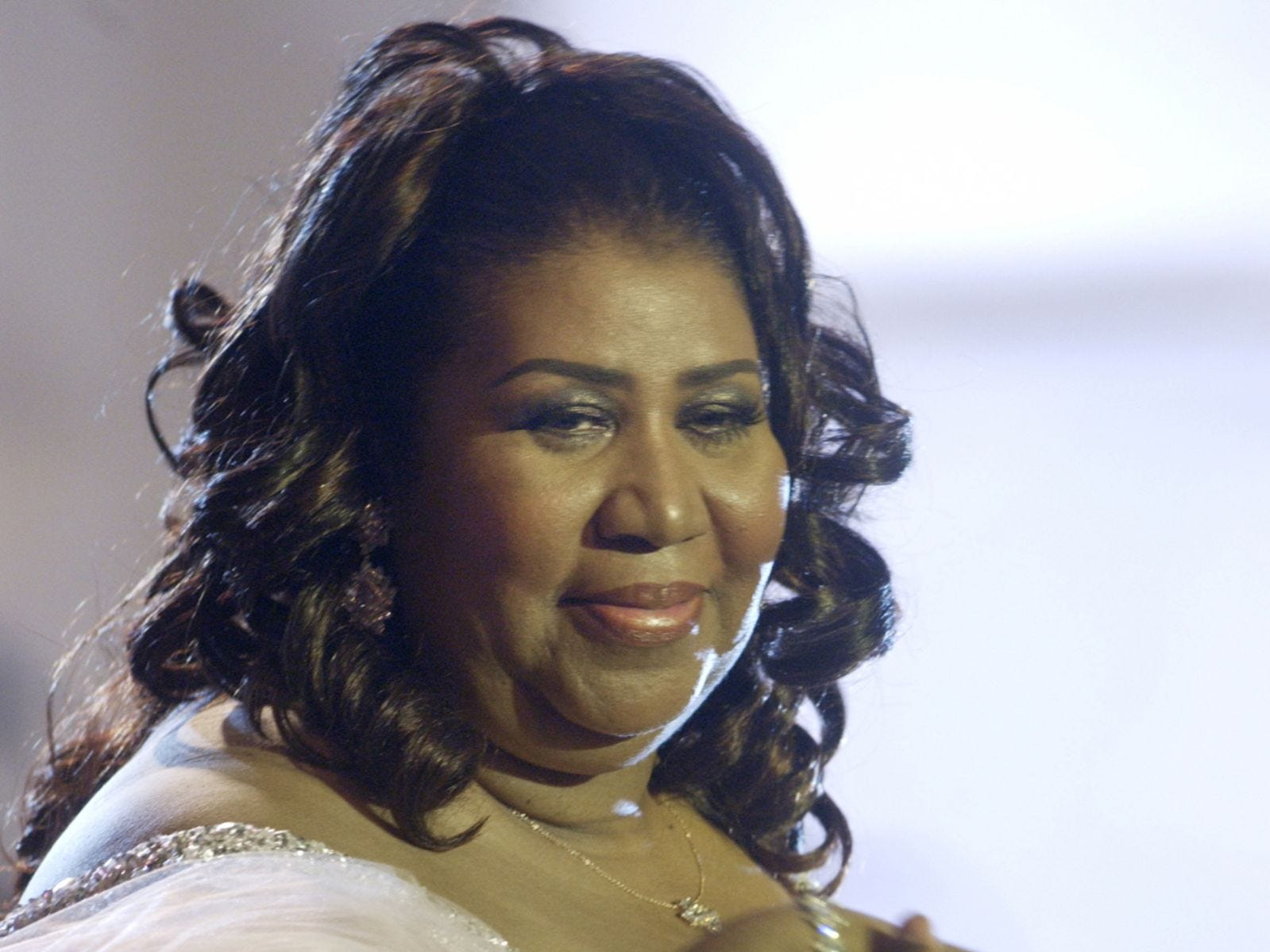 Singer Aretha Frankin is assisted from the stage at BET's studio in Washington Saturday, October 18, 2003 during the BET 9th Annual Walk of Fame: A Tribute to Aretha Franklin.
