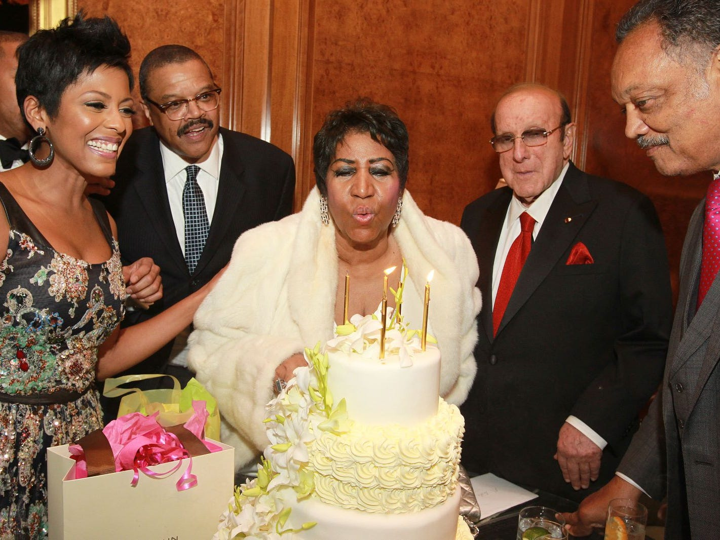 Reporter Tamron Hall, from left, Willie Wilkerson, singer Aretha Franklin, music executive Clive Davis and Rev. Jesse Jackson Sr. attend Aretha Franklin's 74th Birthday Celebration at the Ritz-Carlton on Thursday, April 14, 2016, in New York.