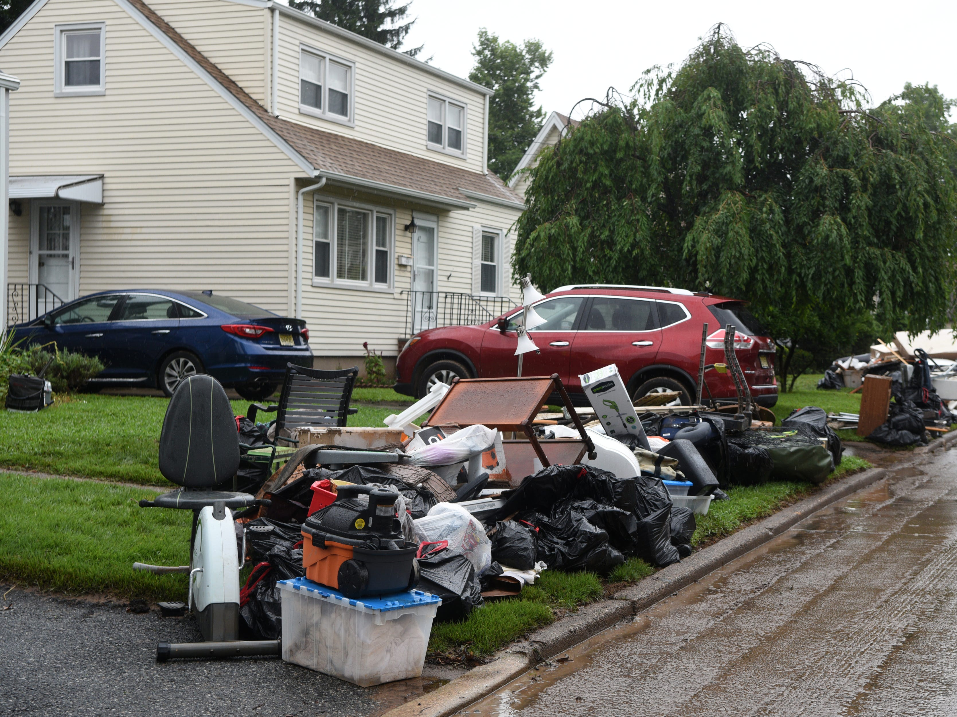 Items ruined in the flood removed from homes on Ryle Ave. in Little Falls sit on the street on Monday, August 13, 2018. Flooding in the neighborhood near the Peckman River on Saturday is being called the worst since Hurricane Floyd.