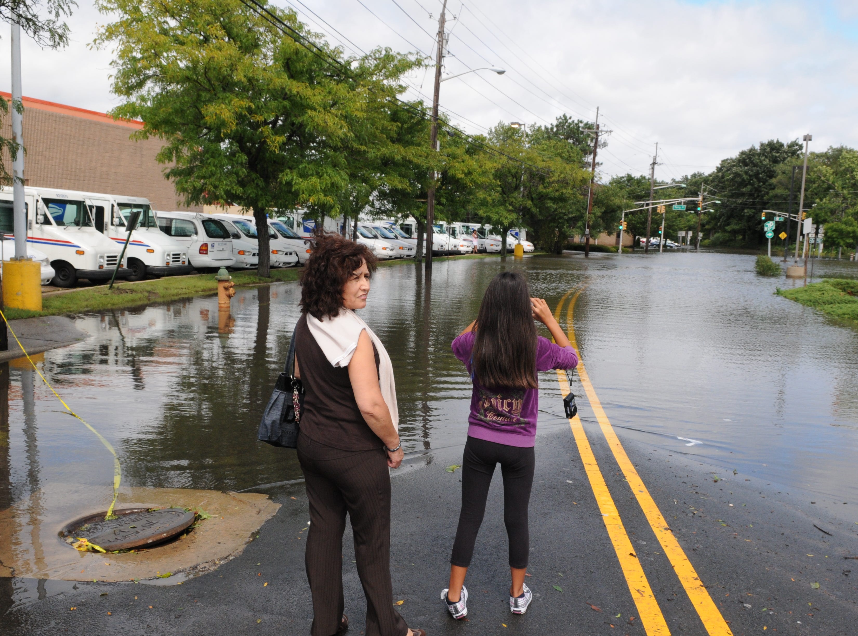 Aug. 28, 2011: The aftereffects of Hurricane Irene's visit are still in evident in Belleville.  Residents investigate and photograph flooding on River Road.
