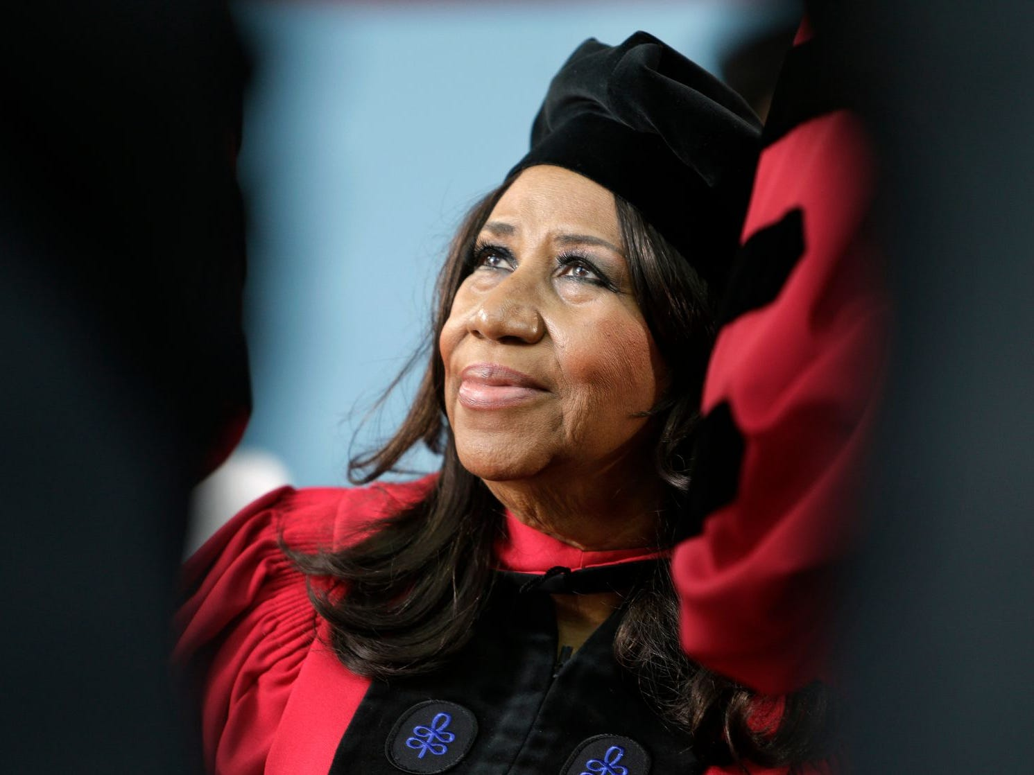 "In a Thursday, May 29, 2014 file photo, singer Aretha Franklin looks up while seated on stage during Harvard University commencement ceremonies, in Cambridge, Mass., where she was presented with an honorary Doctor of Arts degree. Franklin has some harsh words for a New York server at a at a Johnny Rockets restaurant in Lewiston near Buffalo who told the Queen of Soul she wasn't allowed to eat her takeout inside the restaurant. A spokesman for Franklin says on Tuesday, July 22, Franklin ordered a hamburger after performing a sold-out show. But he says the server screamed at Franklin, saying she couldn't sit down to eat because she had ordered takeout. A Johnny Rockets spokeswoman says the franchise owner is sorry for the actions of ""a new and very young employee."""