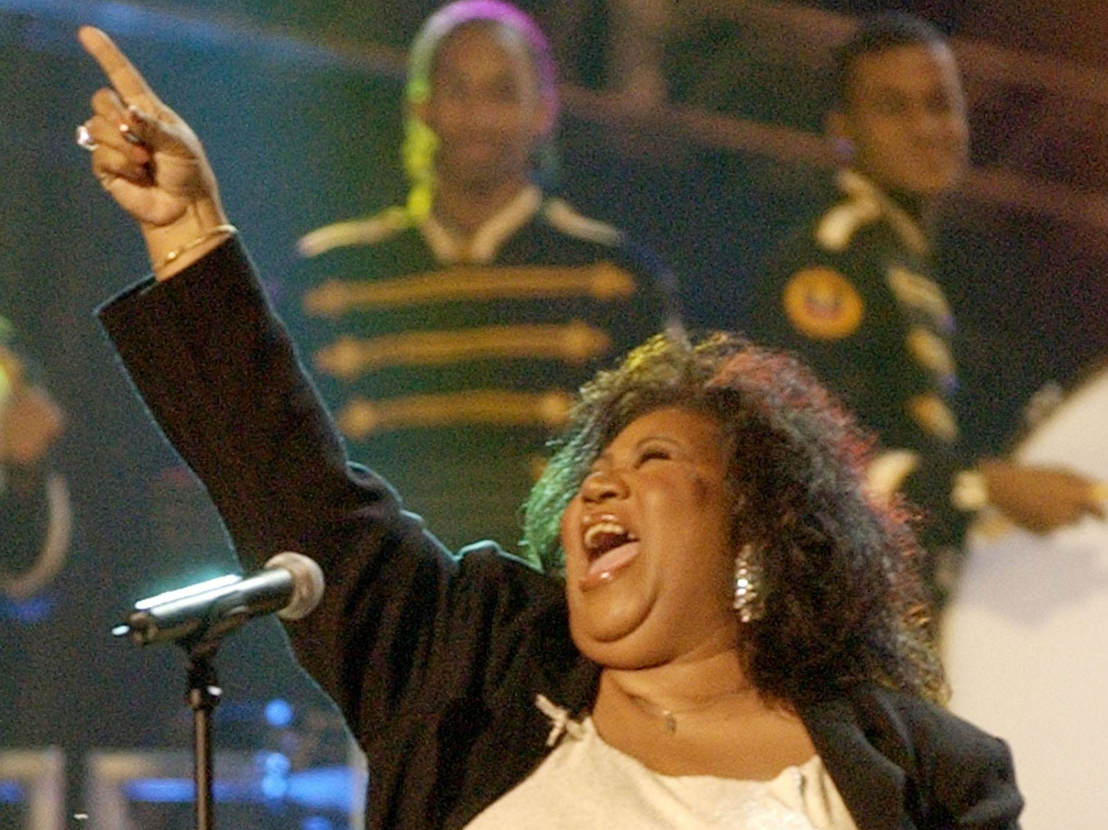 "Aretha Franklin performs the national anthem on the Mall in Washington during ""NFL Kickoff Live 2003"" Thursday, Sept. 4, 2003, in Washington."