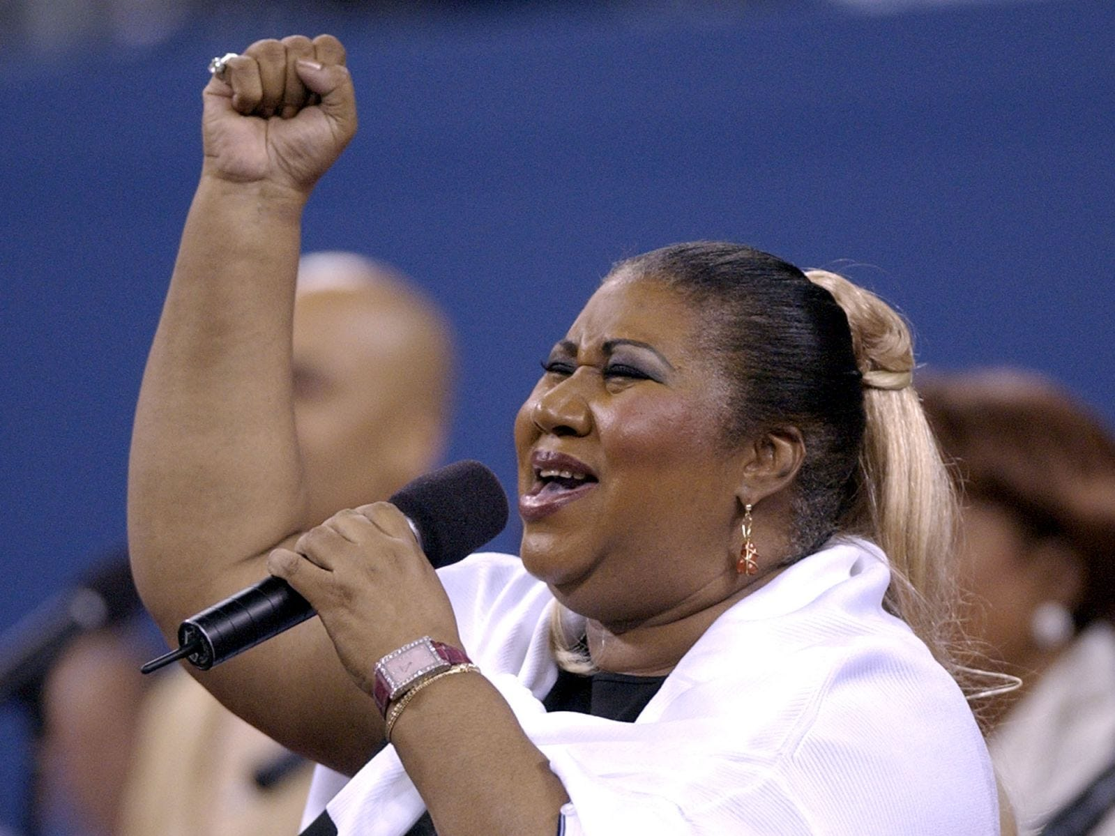 Aretha Franklin sings 'America the Beautiful' before the start of the womens' final between Venus Williams and Serena Williams at the US Open Saturday, Sept. 7, 2002 in New York.