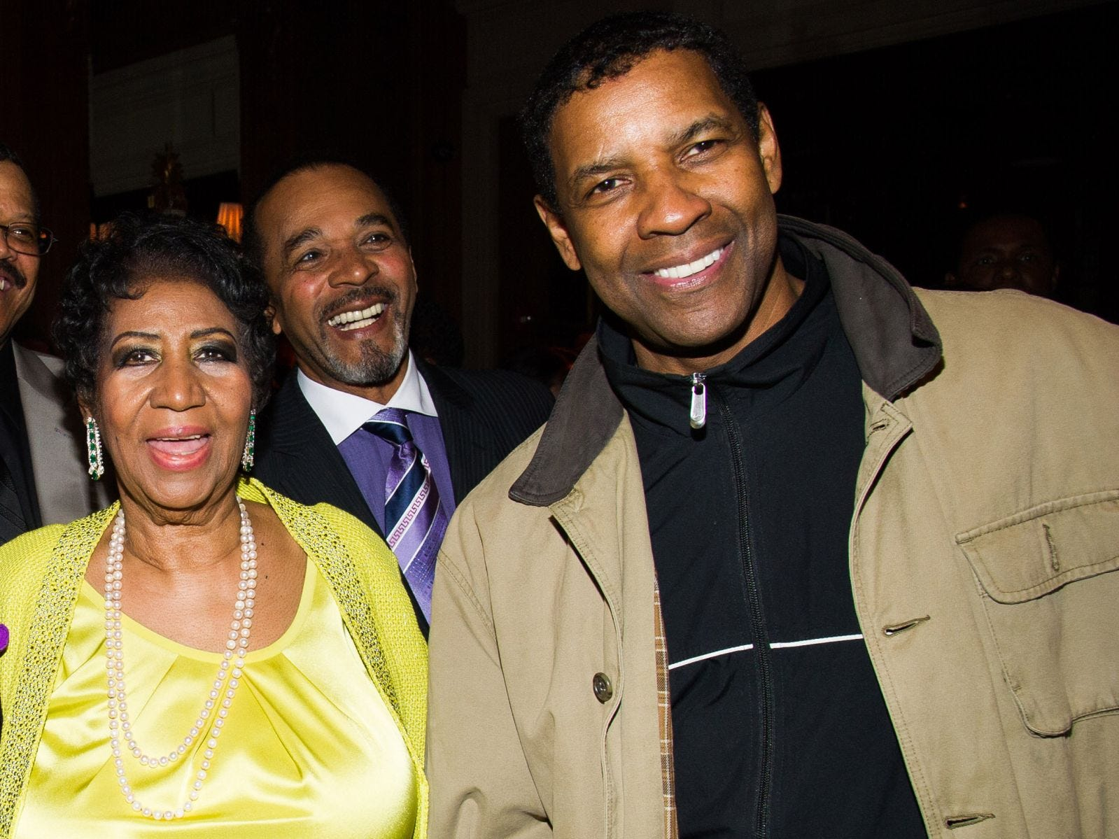 Aretha Franklin and Denzel Washington with Clifton Oliver, rear, attend her 72nd birthday celebration on Saturday, March 22, 2014 in New York.