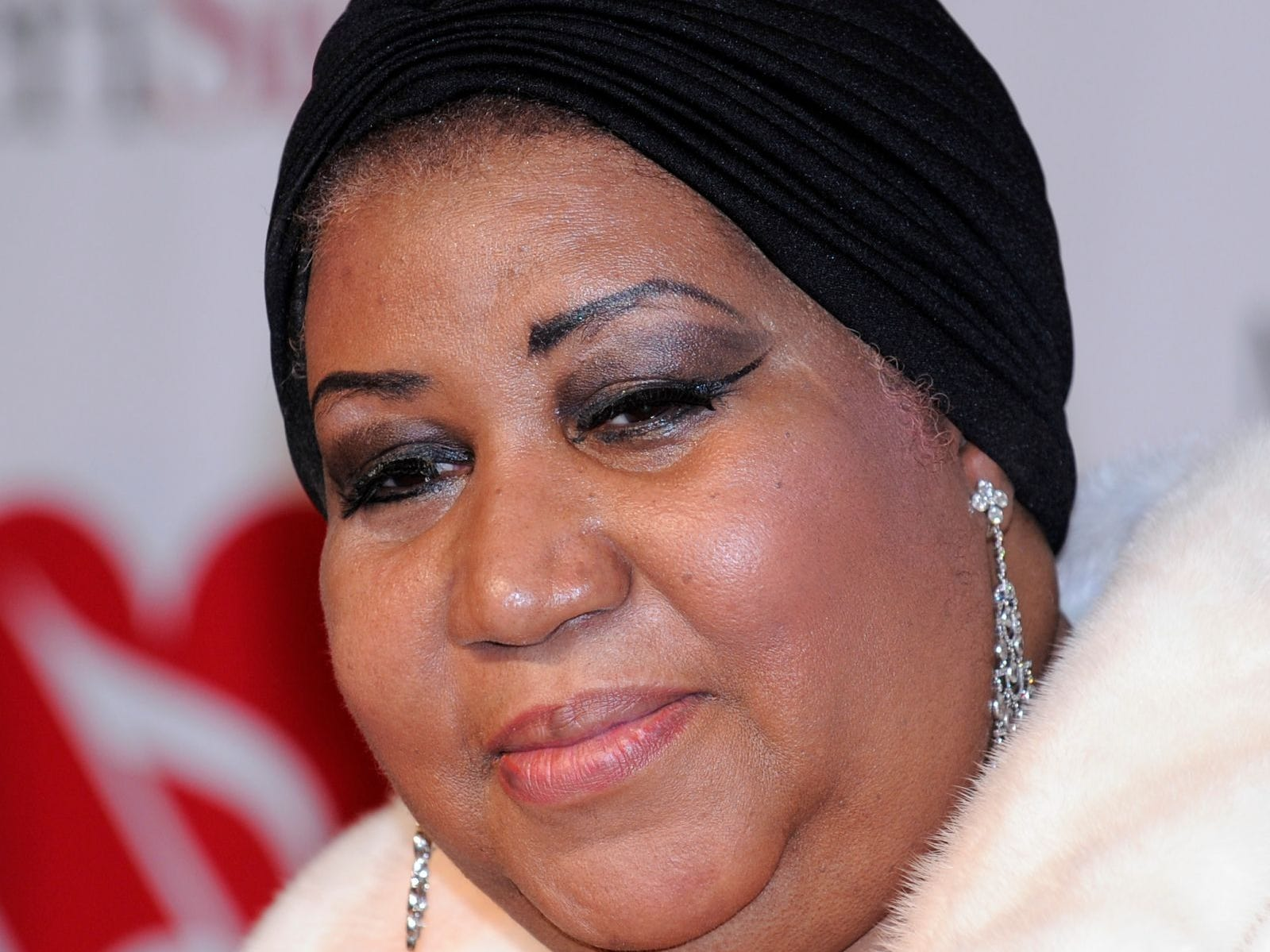 Aretha Franklin poses as she arrives at the MusiCares tribute to her where she was honored as their person of the year, in this  Feb. 8, 2008, file photo in Los Angeles. (AP Photo/Mark J. Terrill, file)
