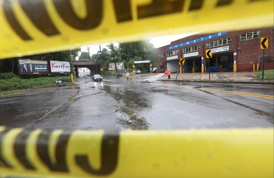 Caution tape is shown in front of the intersection of Elm Ave. and River Rd. in Bogota where a bride had to be rescued from flood waters this past weekend. Monday, August 12, 2018
