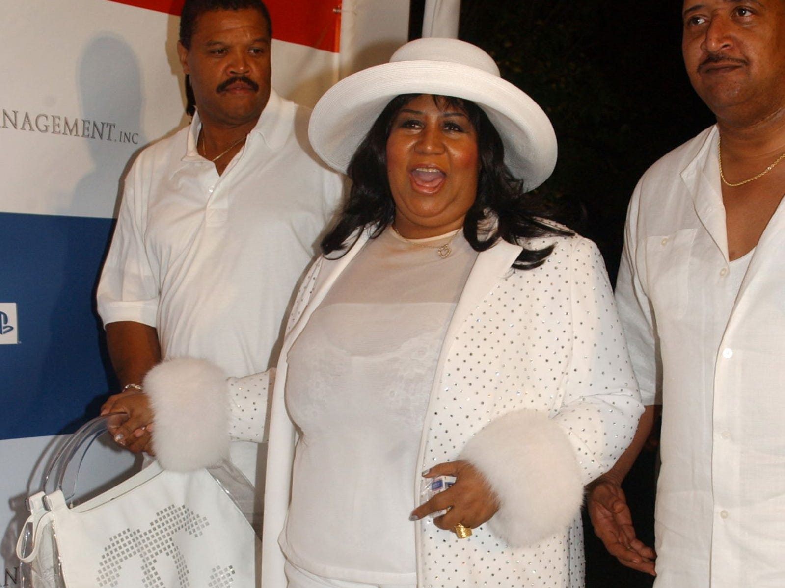 "Aretha Franklin arrives at the annual Independence Day ""White Party"" hosted by Sean ""P. Diddy"" Combs at the PlayStation 2 Estate in Bridgehampton, N.Y., Sunday, July 4, 2004."