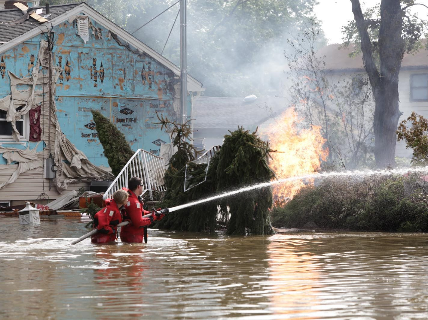 Aug. 30, 2011: Firefighters spray water on what was left of a home on Lincoln Avenue in Pompton Lakes after it was leveled by a gas explosion following the flooding from Hurricane Irene.