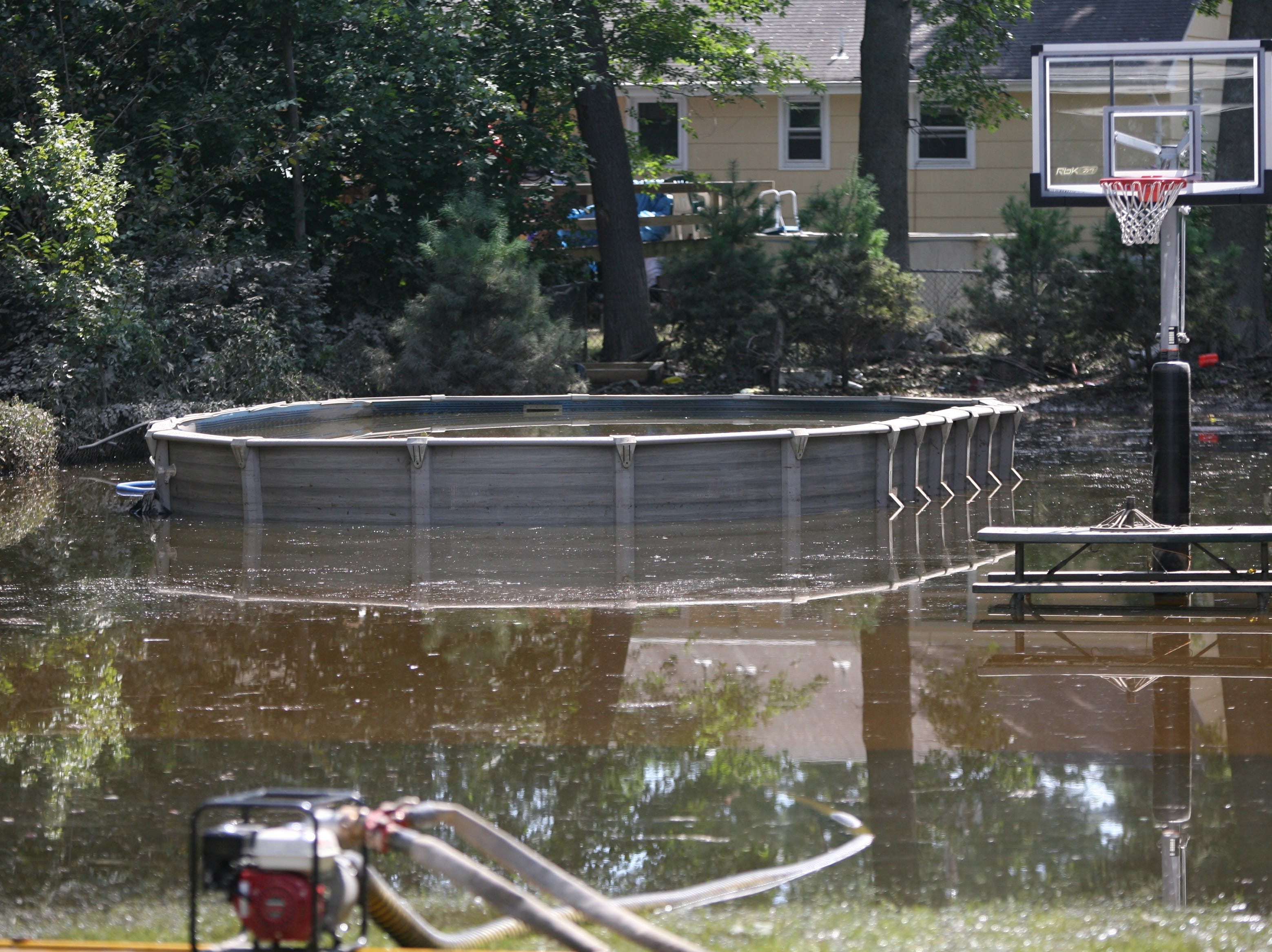 Aug. 31, 2011: Pompton Lakes cleans up from the effects of Hurricane Irene.  A backyard of a home on Dawes Highway is still flooded and being pumped.