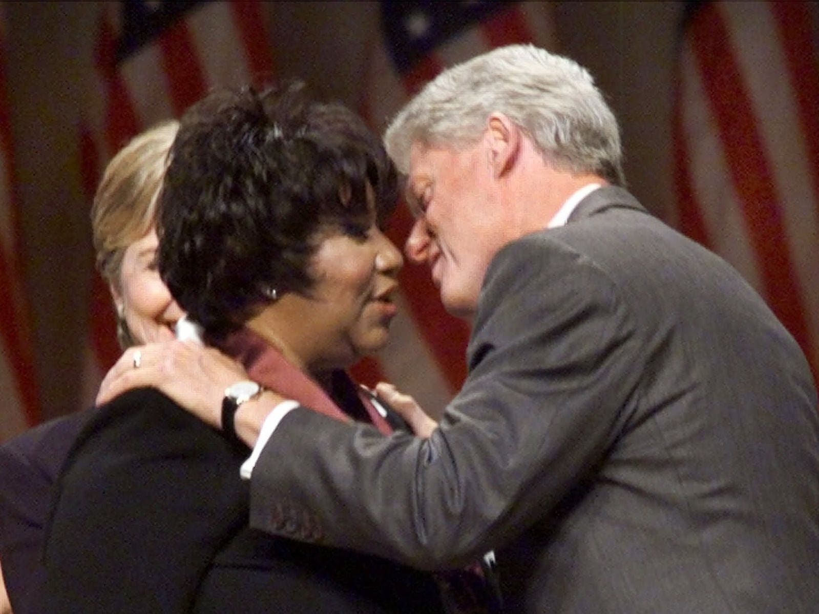 President Clinton prepares to kiss singer Aretha Franklin after awarding her with a National Medal of Arts during a ceremony in Washington Wednesday, Sept. 29, 1999. First lady Hillary Rodham Clinton is at left.