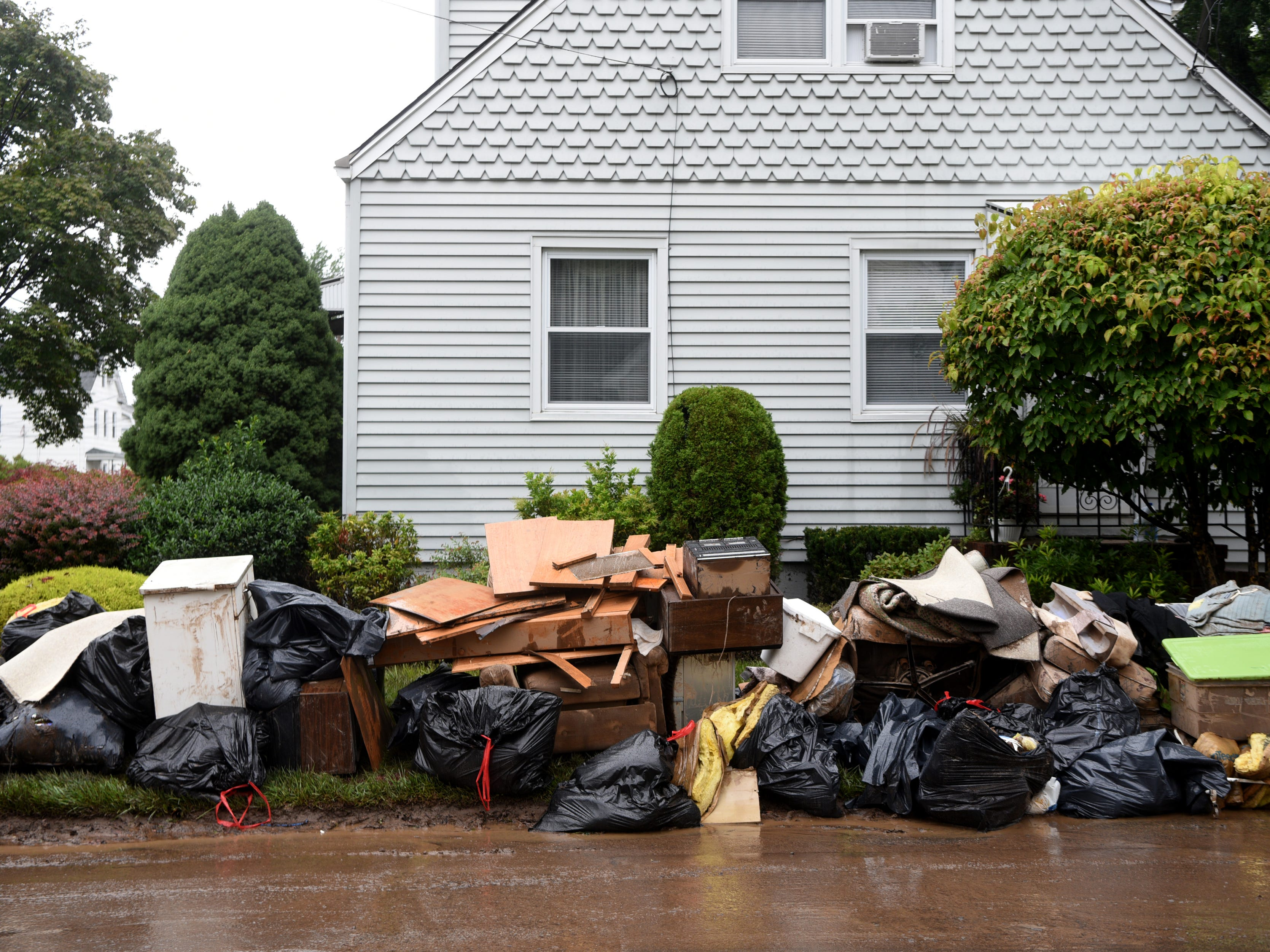 Items ruined in flooding are removed from a home on the corner of Ryle Ave. at the intersection of Harrison St. in Little Falls sit on the street on Monday, August 13, 2018. Flooding in the neighborhood near the Peckman River on Saturday is being called the worst since Hurricane Floyd.