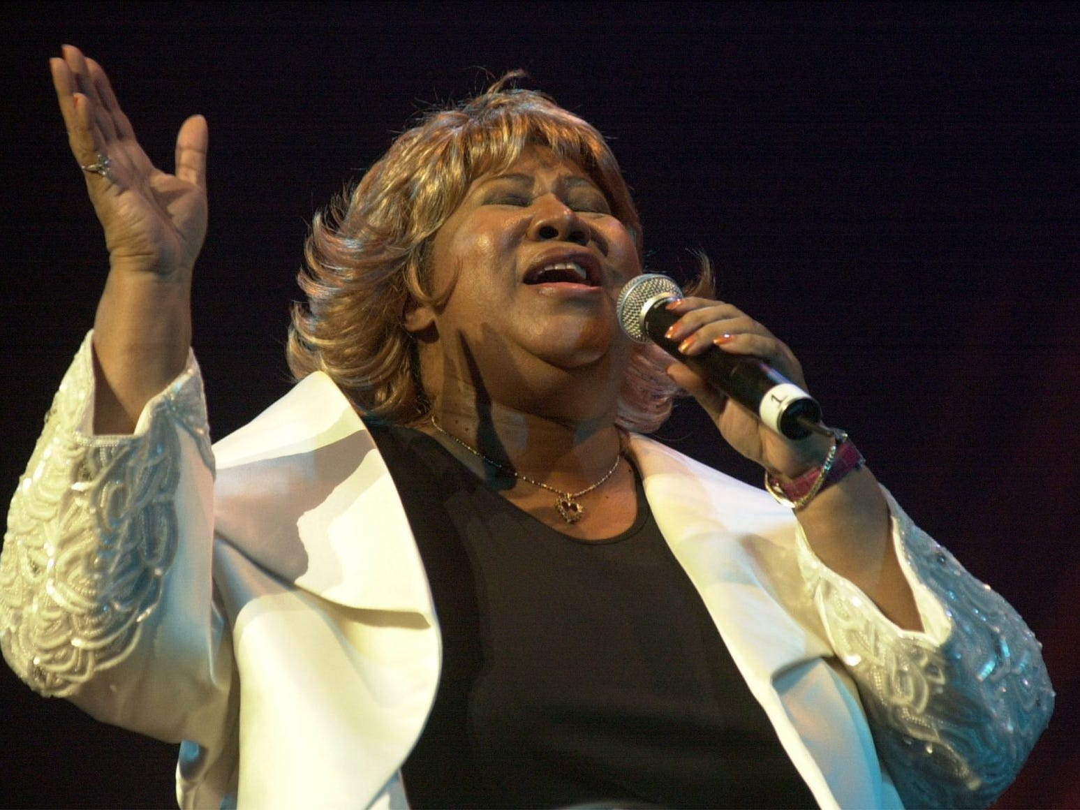 Singer Aretha Franklin performs at the Fox Theater in Detroit during the Southern Christian Leadership Conference's Dr. Martin Luther King. Jr. day celebration on Monday, Jan. 21, 2002.