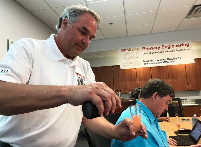 Stephen Taylor, New Mexico State University Department of Chemical and Materials Engineering adjunct professor in the brewery engineering program, pours a beer sample during a sensory evaluation training Aug. 6.