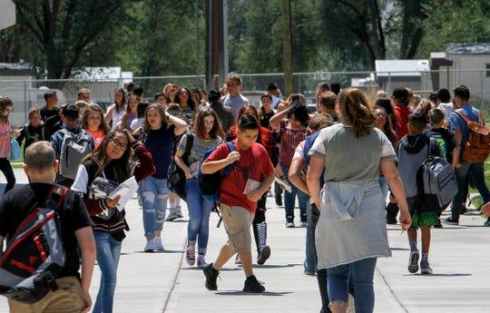 C.V. Koogler Middle School students head to class, Monday at C.V. Koogler Middle School in Aztec.