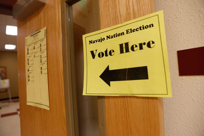A sign directs Navajo voters to a polling station Nov. 8, 2017 in Upper Fruitland. An effort by a voter to uncover details about the tribe's 2014 general election has been rebuffed by the Navajo Board of Election Supervisors.