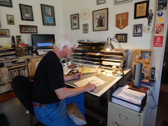 Graphic illustrator, Rick Geary, demonstrates his work during the 2017 Arts Festival and Studio tour.