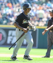 Clarenceville grad Lusire Boyd Jr. brings a bat back to the Miami Marlins dugout during a game at Comerica Park.