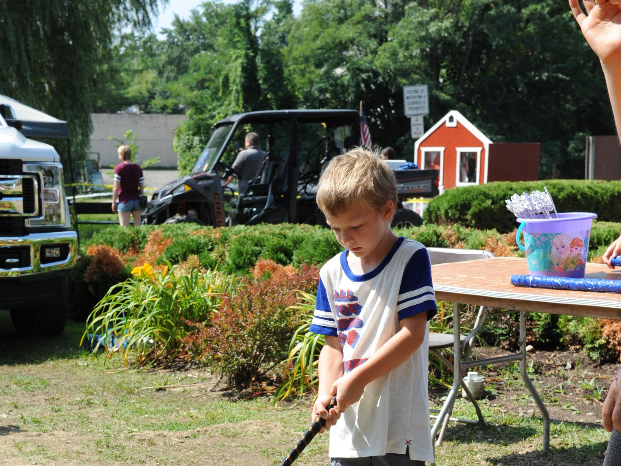 Eddie Parker practices his putting skills at Milford Memories.