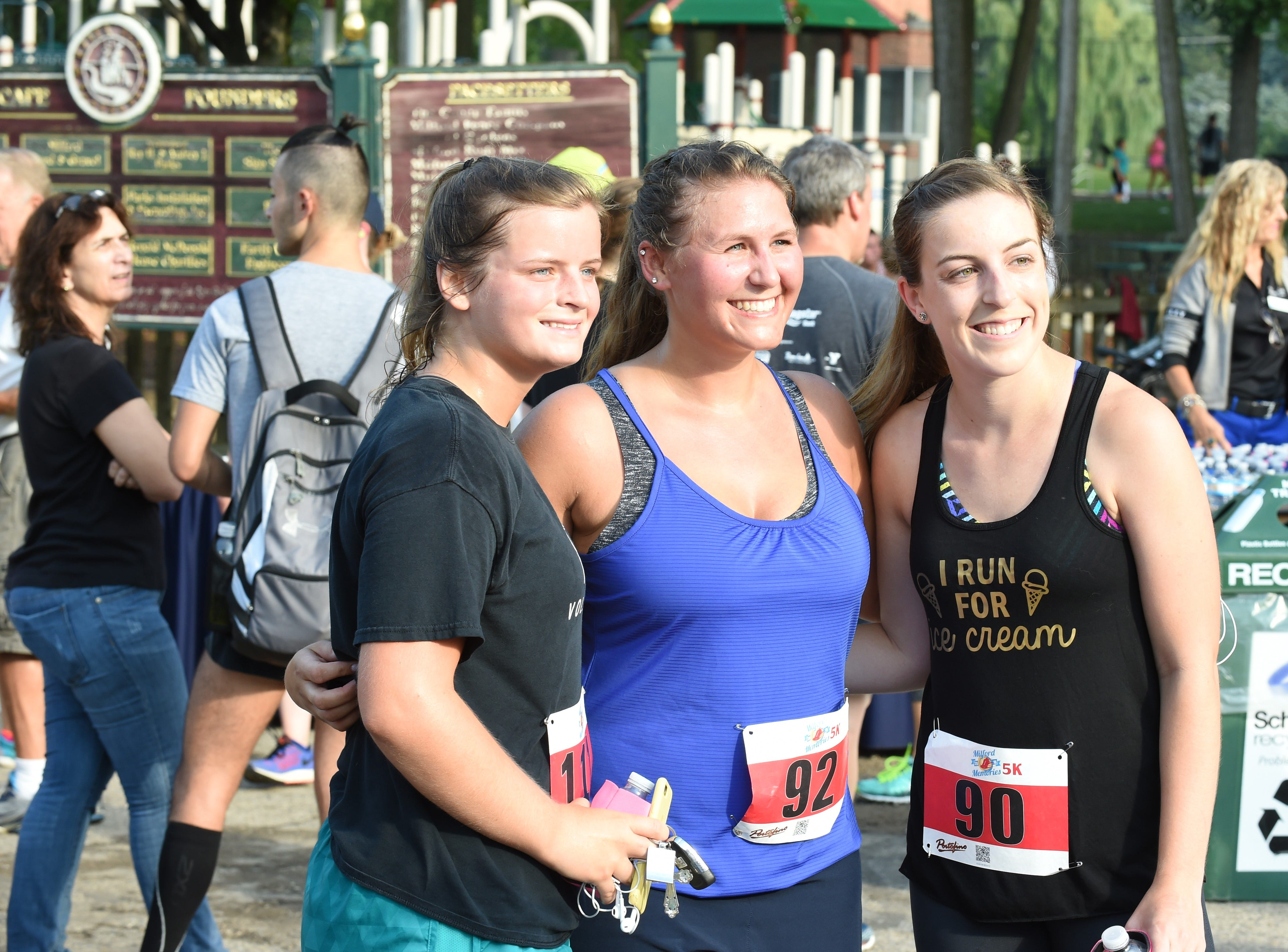 Lifetime friends, Abbi Hill, Samantha Simmons and Lyndsay Mahar take a photo after participating in the 5K run in Milford.