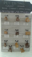 Waggz pet tags are available in different sizes, dark or light wood, and in the shape of a bone, heart or Michigan, as well as other states.