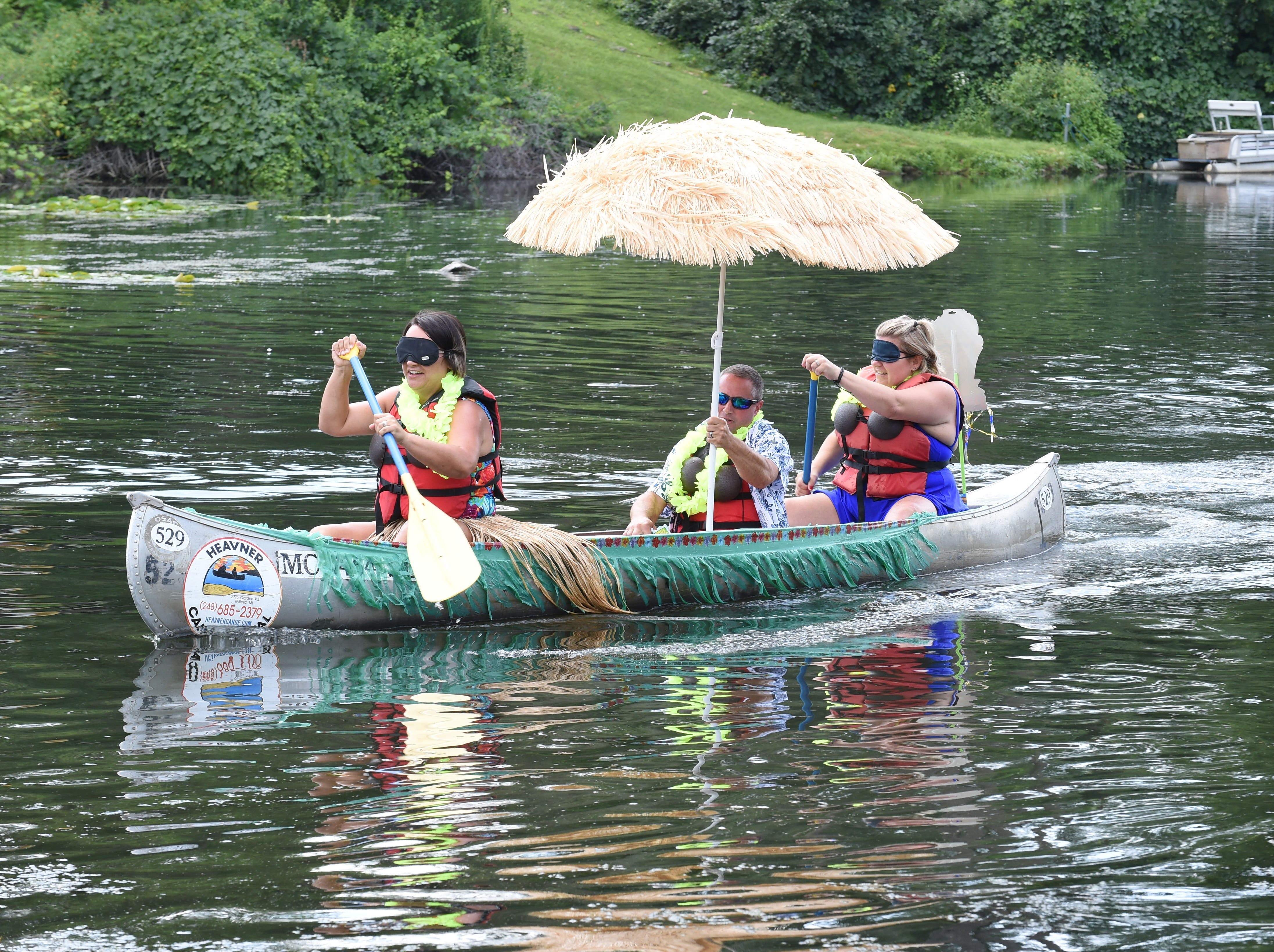 """Kendrin Gall, Dave Scapone and wife Jeanine take part in the """"Blind Canoe"""" race held Sunday in Milford."""