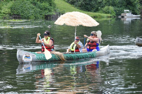 Kendrin Gall, Dave Scapone and wife Jeanine take part in the Blind Canoe Race held Sunday of Milford Memories.